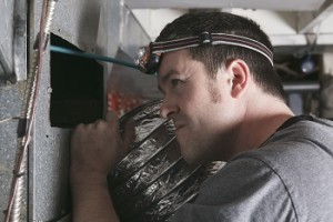Professional air duct cleaning technician